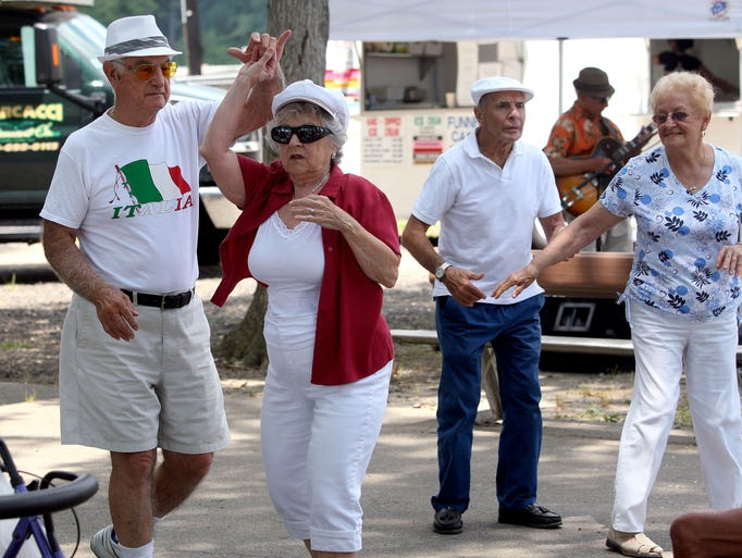 Tony Carbonara dances with Rosemarie Pindale, both of Vineland, while Benjamin Capolingua dances with Josephine DiDomenico, both of Landisville, from left, during the Italian Day chicken barbeque at Bruno Melini Park in Minotola, Sunday, Jun. 29, 2014.  Staff Photo/Sean M. Fitzgerald