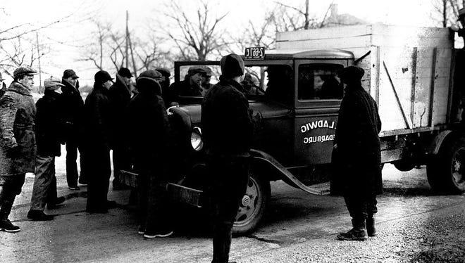 Milk Strikers hold up trucks near Saukville along Highway 57.  February 20, 1933.