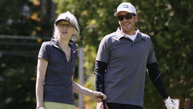 Bode Miller shares a laugh with his mother, Jo, during his Bode Bash charity golf tournament in Bethlehem, N.H. on Aug. 25.