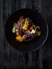 Charred octopus with gigante marinati apricot mostarda