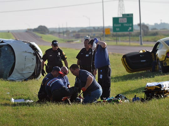 Burkburnett Police and first responders treat a man at the scene of a two-car rollover accident Thursday morning on I-44 northbound near East Third Street. The male driver of the Honda was taken to United Regional hospital with serious injuries.