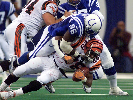 Colts Shawn King hits Cincinnati's Corey Dillon in