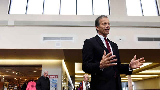Senator John Thune speaks with the media about airport security Friday at the Sioux Falls Regional Airport.