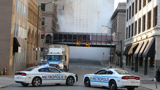 """Two Metropolis police cars are part of filming for the superhero movie """"Batman v. Superman: Dawn of Justice"""" in downtown Detroit in August 2014."""