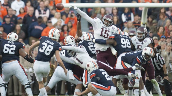 Texas A&M defensive lineman Myles Garrett (15) blocks a field goal attempted by Auburn kicker Daniel Carlson last year.