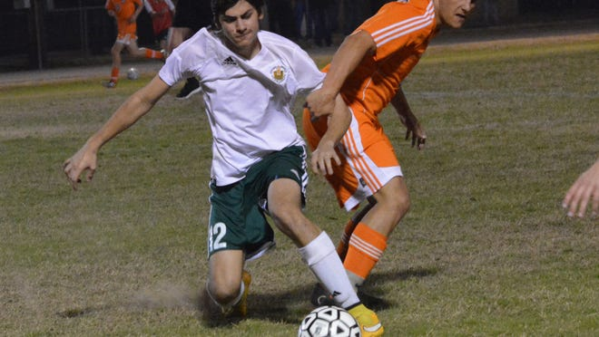 Menard's Tyler Mathews (12, left) and St. Louis' Joseph Manuel (3, right) fight for control of the ball Wednesday.