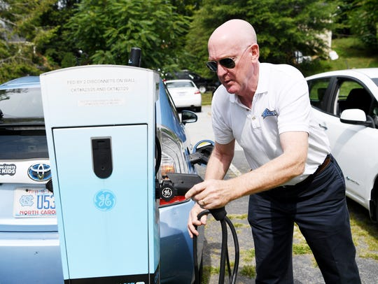 Dave Erb, a member of the Blue Ridge EV Club, places