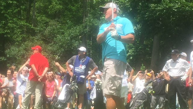 Brett Favre tees off on the 10th hole Saturday afternoon at University Ridge in Madison.