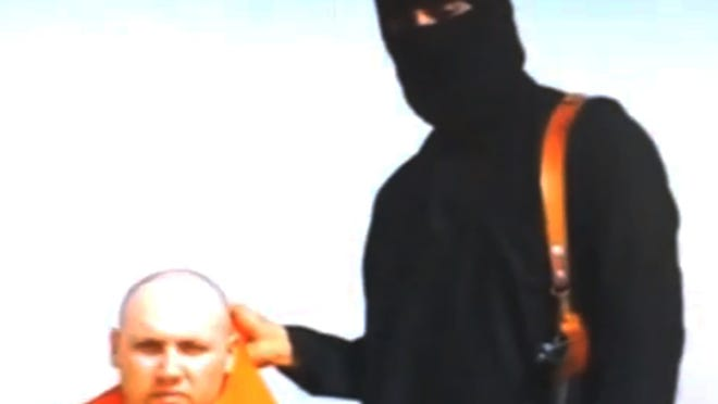 An undated video released by the Islamic State of Iraq and Syria shows journalist Steven Sotloff being held captive. Sotloff was reportedly murdered by ISIS.