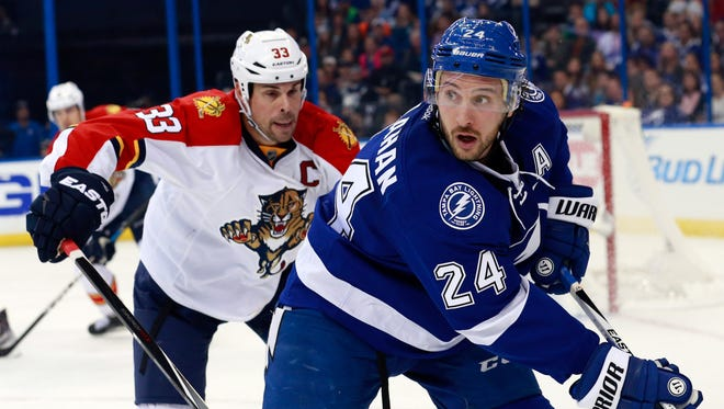 Tampa Bay Lightning right wing Ryan Callahan (24) skates with the puck as Florida Panthers defenseman Willie Mitchell (33) defends during the second period at Amalie Arena. Mandatory Credit: Kim Klement-USA TODAY Sports