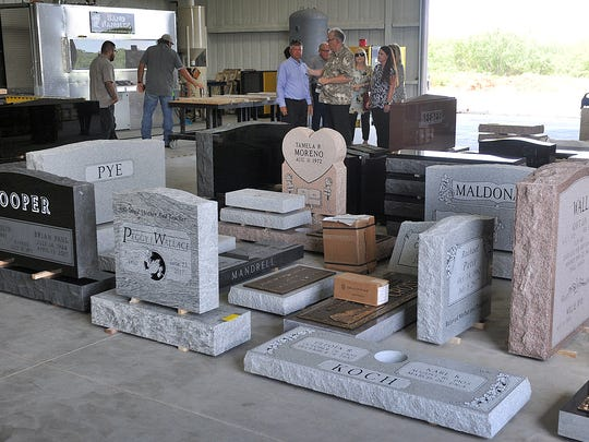 Sample monuments and headstones were displayed as the public was invited to the grand opening of Austin Stone and Monument Tuesday morning. The business is family-owned and does all work in-house at the new 6,000 square-foot facility.