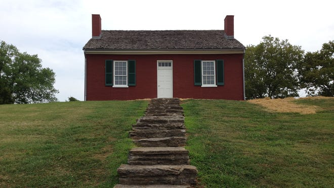 The Rankin House has undergone a complete restoration, including a new roof, shutters, painted to the original brownish red, and the elimination of a period-inaccurate portico over the front door.