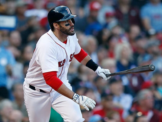 Boston Red Sox's J.D. Martinez watches his three-run home run during the fourth inning of a baseball game against the New York Yankees in Boston, Sunday, Sept. 30, 2018. (AP Photo/Michael Dwyer)