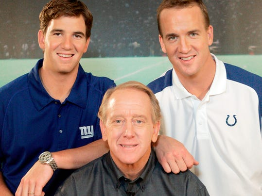 FILE - In this May 8, 2008, file photo, Archie Manning, center, is joined by his sons Eli Manning, left, and Peyton Manning, in Beverly Hills, Calif. Duke guard Lexie Brown was excited to be invited to New York for the WNBA draft next week. Brown was working out at Cameron Indoor Stadium on Thursday, April 5, 2018, when Eli and Peyton came into the famed building along with a bunch of the New York Giants. (AP Photo/Reed Saxon, File)