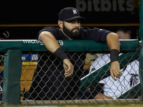 Tigers catcher Alex Avila (31) watches from the dugout during the eighth inning of the Tigers' 6-5 loss to the Astros on Friday, July 28, 2017, at Comerica Park.