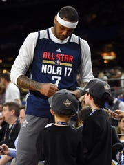 Knicks star Carmelo Anthony, an Eastern Conference All-Star, signs autographs during the NBA All-Star Practice at the Mercedes-Benz Superdome on Feb 18, 2017 at New Orleans, LA.