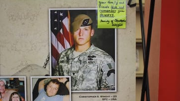 Personal notes from friends or family members adorn some of the panels of the Remembering Our Fallen display in the Jeffersonville Township Public Library. January 22, 2016.