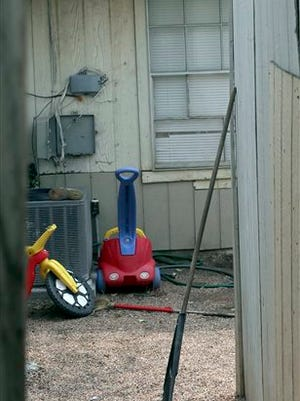 This is the back yard of the townhouse at in San Antonio, Texas, Friday, April 29, 2016, where children were allegedly chained up in the backyard.