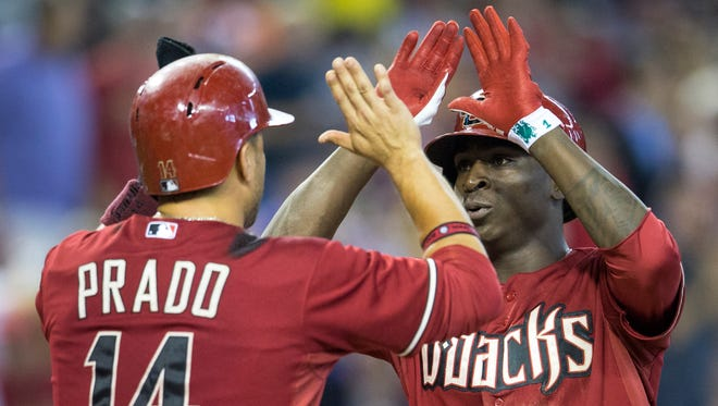 Arizona Diamondbacks' Martin Prado congratulates Didi Gregorius as the two scored on Gregorius' homer in the fifth inning as the D-Backs play the Detroit Tigers in an interleague game at Chase Field on July 23, 2014.