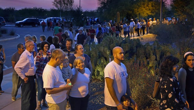 People wait in line to vote in the primary March 22 in Chandler, Arizona. Residents in metro Phoenix have bristled for years over a perception that state leaders want to make it harder for them to vote, and the recent mess at the polls only heightened the frustration.