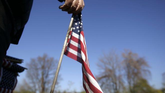Man holds a flag.