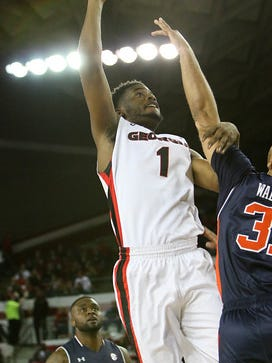 Georgia forward Yante Maten (1) shoots the ball during the Bulldogs' game at Stegeman Coliseum against the Auburn University in Athens, Ga., on Saturday, Feb. 06, 2016.