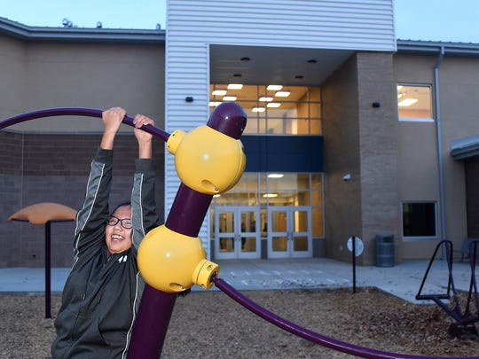 Fifth-grader Jasmyn Miller checks out the new playground equipment at Judy Nelson Elementary School on Wednesday in Kirtland.