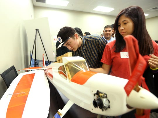 Odem High School students Gavin Dvorak (left), 16, and Breanna Martinez, 17, check out a plane that will be converted to a UAS that was donated to Del Mar College  on Wednesday, Nov. 16, 2016 during the Map Your Career with Geographic Information Systems event at the Del Mar College Economic Development Center. About 800 students from across the Coastal Bend attended the event.