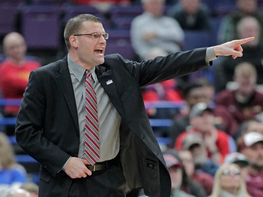 Bradley head coach Brian Wardle calls in a play during the first half of an NCAA college basketball game against the Drake in the quarterfinals of the Missouri Valley Conference tournament, Friday, March 2, 2018, in St. Louis. (AP Photo/Tom Gannam)