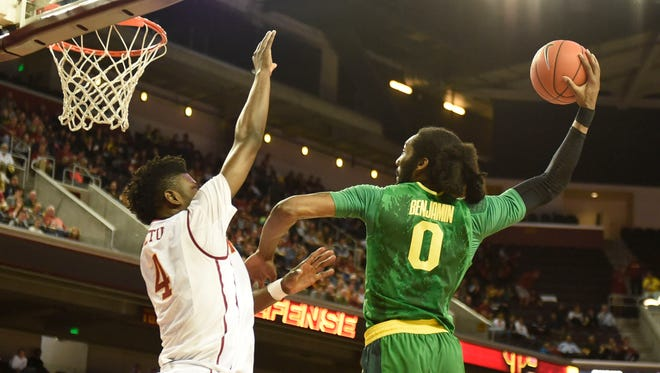 Mar 5, 2016; Los Angeles, CA, USA; Oregon Ducks forward Dwayne Benjamin (0) goes up for a dunk against Southern California Trojans forward Chimezie Metu (4) during the game at Galen Center. Mandatory Credit: Richard Mackson-USA TODAY Sports