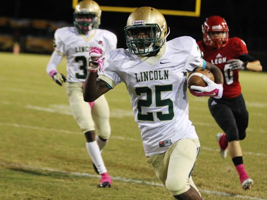 Lincoln safety Vincent Johnson returns a punt for a
