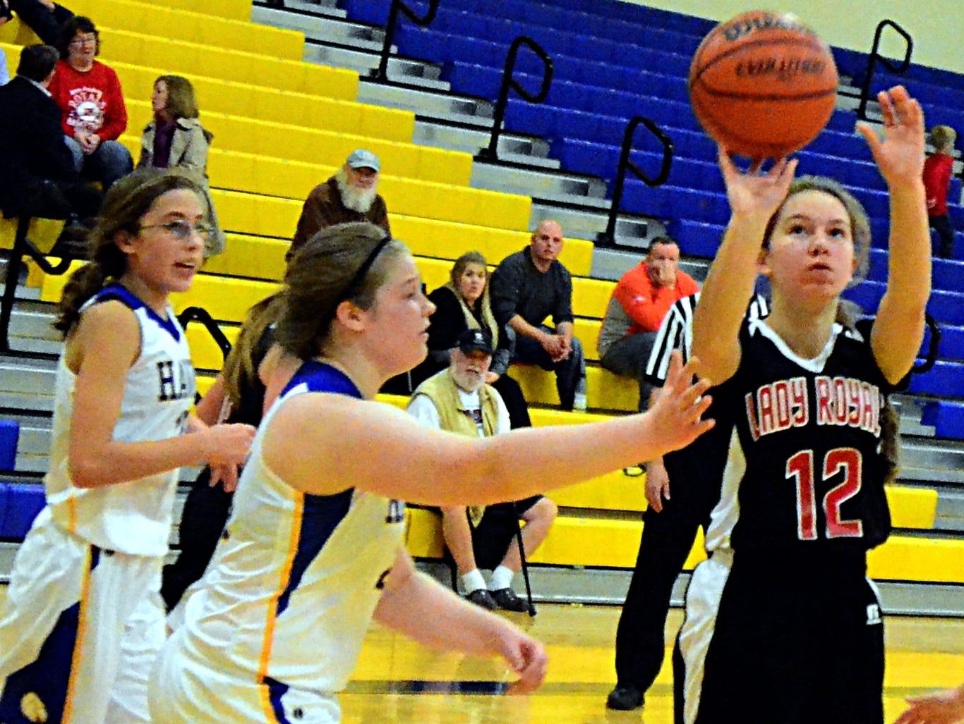 Aaron Academy freshman Dailyn Hannah elevates to shoot under pressure from Merrol Hyde Magnet sophomore Lauren Buchanen during third-quarter action.
