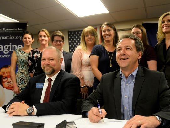 Governor Steve Bullock, right, signs HB391, the Montana