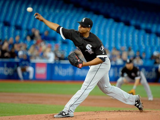 Chicago White Sox starting pitcher Reynaldo Lopez throws to the Toronto Blue Jays during first-inning baseball game action in Toronto, Monday, April 2, 2018. (Nathan Denette/The Canadian Press via AP)