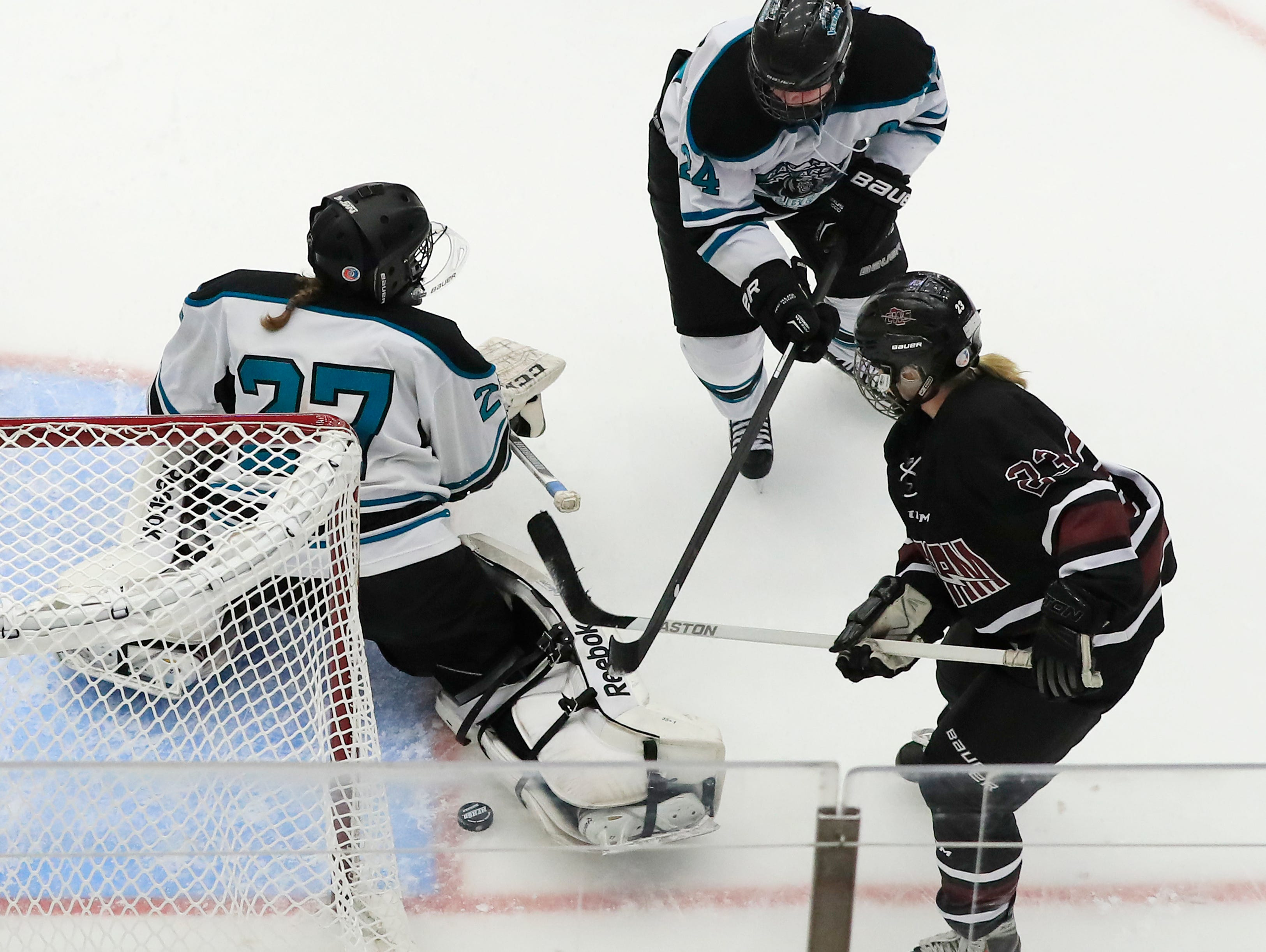 Bay Area Ice Bears defenseman Mia Dunning (24) clears the puck away from Bay Area Ice Bears defenseman Mia Dunning (24) after a save by Ice Bears goalie Ana Holzbach (27) in the championship match at the 2017 State Hockey Tournament at Veterans Memorial Coliseum on Saturday, March 4, 2017, in Madison, Wis. The Storm won the match 2-1 in overtime. Adam Wesley/USA TODAY NETWORK-Wisconsin