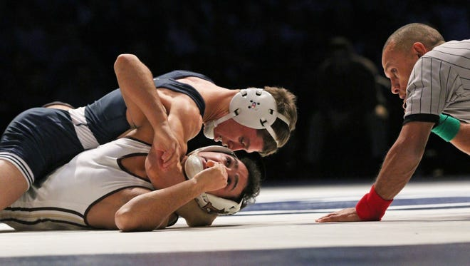 Nick Suriano, in blue, downed Lehigh All-American Darian Cruz, 7-0, earlier this month. Suriano, who went unbeaten in his high school career, is off to an 8-0 start with the Nittany Lions.