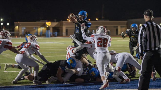 Hutchinson High School's quarterback Myles Thompson jumps over the goal line late in the fourth quarter to put the Salthawks ahead of Maize 32-28 at Gowans Stadium on Oct. 23, 2020. Thompson ran the ball for 16 yards with two touchdowns.