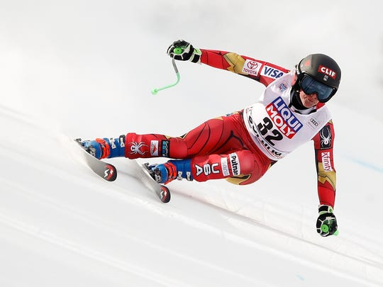 Stacey Cook speeds down the course during an alpine ski, women's World Cup super-G, in Cortina D'Ampezzo, Italy on Jan. 21,