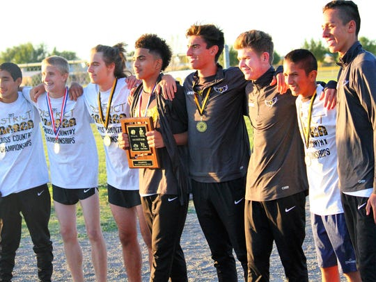 The Alamogordo boys' cross country team captured their