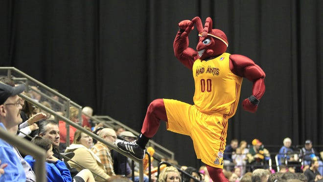 FILE -- The Mad Ant mascot is constantly in motion around the arena as he engages the fans, January 31, 2013.