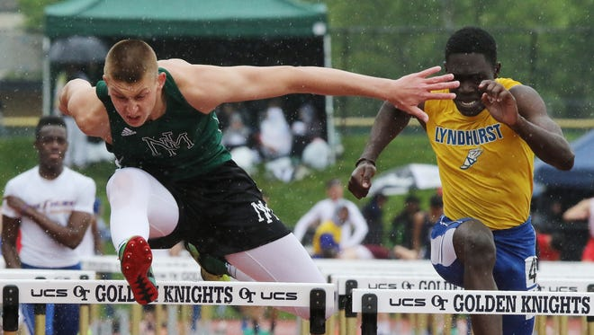 Ryan Picinic of New Milford in front of Teslim Olunade of Lyndhurst in the Boys 110 meter hurdles in the C division.