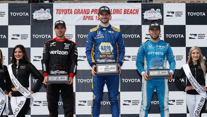 Alexander Rossi, center, celebrates on the podium after winning the Toyota Grand Prix of Long Beach with runner-up Will Power, left, and third-place finisher Ed Jones. Photo by Joe Skibinski for Verizon IndyCar Series