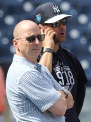Yankees workout this afternoon. General manager Brian Cashman with former Yankee Nick Swisher by the batting cage.