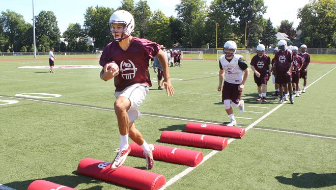 QB Jake Zembiec leads his group through agility drills during preseason practices for Aquinas.