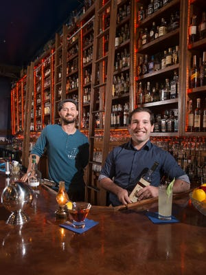 Bartenders Patrick Bolster, owner of the Union Public House, left, and Andrew Pope, of the Old Hickory Whiskey Bar, pose behind the bar at the Old Hickory Whiskey Bar in Pensacola on Monday, March 20, 2017.  Pope and Bolster are among the founders of the new Pensacola chapter of the United States Bartenders' Guild.