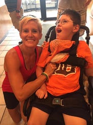 Mary Faber and her son, J.T., after completing the