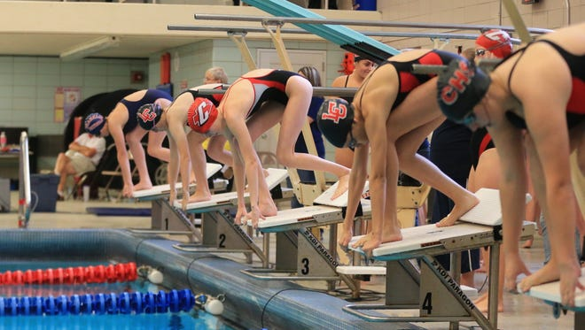 Swimmers get set to begin a race during Saturday's KLAA South Division meet at Westland John Glenn.