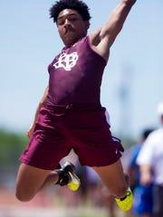 Flour Bluff's Isaac Miles competes in the long jump during the Chatter Allen Relays at Cabaniss Stadium on Thursday, March 29, 2018.