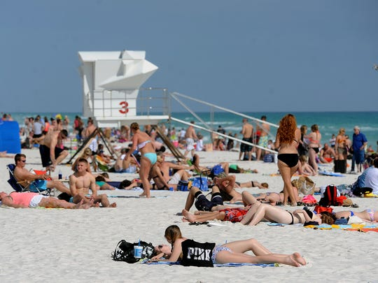 Spring breakers take advantage of the nice weather Sunday at Pensacola Beach.