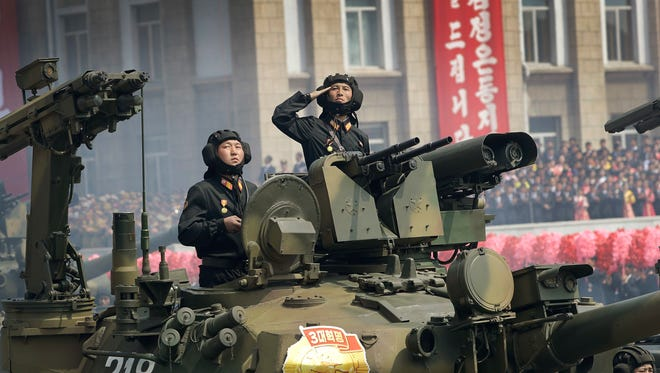 Soldiers in tanks are paraded on the Kim Il Sung Square during a military parade on Saturday in Pyongyang, North Korea to celebrate the 105th birth anniversary of Kim Il Sung, the country's late founder and grandfather of current ruler Kim Jong Un.